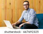 happy man with glasses working... | Shutterstock . vector #667692325