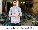 happy man with laptop in hands. ... | Shutterstock . vector #667692355