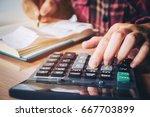 businessman's hands with... | Shutterstock . vector #667703899