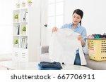 happy beautiful woman holding...   Shutterstock . vector #667706911