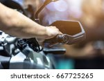 human hand in a motorcycle... | Shutterstock . vector #667725265