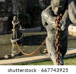 Statue Of A Slave Carrying A...