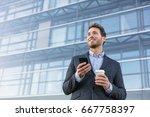 business man holding phone... | Shutterstock . vector #667758397