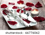 place setting for lovers with rose petals - stock photo