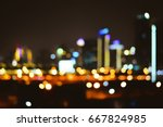 City night blurred bogeh light city scape downtown, abstract background. Blurred focus of big city in the night time. Concept background decorate Web pages, book covers, interior and billboards