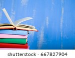 stack of books on a blue... | Shutterstock . vector #667827904