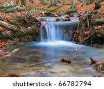blue stream in autumn forest | Shutterstock . vector #66782794