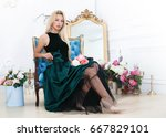 gorgeous woman sitting in... | Shutterstock . vector #667829101