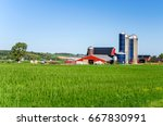 Farm Buildings With Silos In...