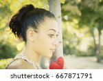 a pretty romantic girl looking... | Shutterstock . vector #667871791