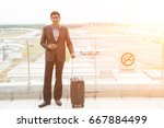 indian male walking at airport   | Shutterstock . vector #667884499