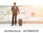 indian male walking at airport   | Shutterstock . vector #667884535