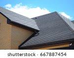 asphalt shingles roofing...   Shutterstock . vector #667887454