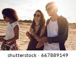 smiling group of friends... | Shutterstock . vector #667889149