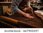 close up of a male shoemaker... | Shutterstock . vector #667903357