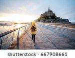 young female traveler in yellow ... | Shutterstock . vector #667908661