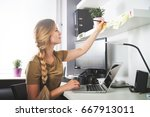 woman working on computer at...   Shutterstock . vector #667913011