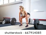 woman doing deadlift exercise ... | Shutterstock . vector #667914085