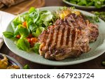 grilled pork chops with with... | Shutterstock . vector #667923724