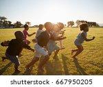 elementary school kids running... | Shutterstock . vector #667950205