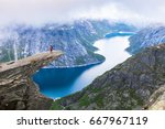 female hiker standing on... | Shutterstock . vector #667967119