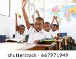 kids raising hands during a... | Shutterstock . vector #667971949