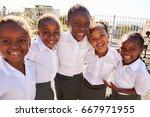 young african schoolgirls in... | Shutterstock . vector #667971955