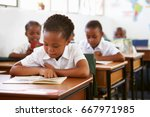 schoolgirl reading at her desk... | Shutterstock . vector #667971985