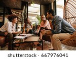 group of creative people having ... | Shutterstock . vector #667976041