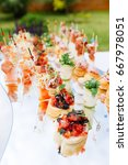 beautifully decorated catering... | Shutterstock . vector #667978051