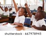 kids raising hands during... | Shutterstock . vector #667978945