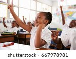 schoolgirl raising hand during... | Shutterstock . vector #667978981