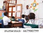 teacher welcomes kids sitting... | Shutterstock . vector #667980799