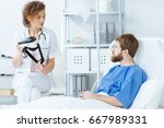 young female doctor showing vr... | Shutterstock . vector #667989331