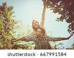 boyfriend carries the girl on... | Shutterstock . vector #667991584