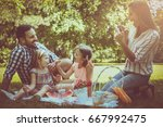 happy family enjoying in picnic ... | Shutterstock . vector #667992475