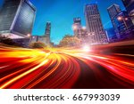 abstract light trails on the... | Shutterstock . vector #667993039