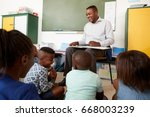 elementary school teacher... | Shutterstock . vector #668003239