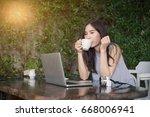beautiful young woman using... | Shutterstock . vector #668006941