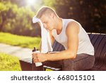 exhausted male after exercise... | Shutterstock . vector #668015101
