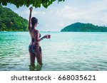 happy woman in bikini relaxing... | Shutterstock . vector #668035621