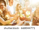 summer party. friends at cafe... | Shutterstock . vector #668044771