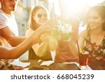 summer party. friends at cafe... | Shutterstock . vector #668045239