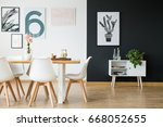black and white wall in dining... | Shutterstock . vector #668052655