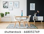 wooden table with flowers... | Shutterstock . vector #668052769