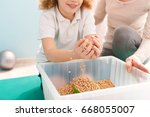 boy playing with chickpeas... | Shutterstock . vector #668055007