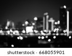 City night blurred bogeh light cityscape downtown in B&W, abstract background. Blurred focus of big city in the night time. Concept background decorate Web pages, book covers, interior and billboards.