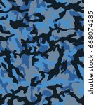 abstract camouflage pattern.... | Shutterstock .eps vector #668074285
