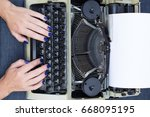 the writer's hands on a... | Shutterstock . vector #668095195