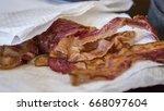 bacon on paper towel   Shutterstock . vector #668097604